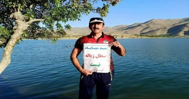 Boats and environmental activists cleared the margins of the Mahabad dam